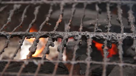 heating up metal : Old grill grate covered in dirty fat lying on open fire, heating for barbecue