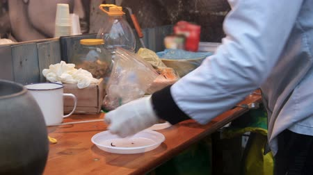 poorness : Man cooking vegetables on dirty table at cheap eatery, product quality control