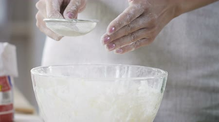 gently : Hostess gently sifting flour through sieve into large bowl, confectionery making