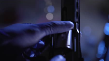 par : Criminalist conducting forensic examination of revolver, checking barrel closeup Stock Footage