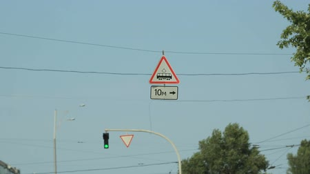 crossway : Road signs seen from car moving along city street, traffic rules, speed limit