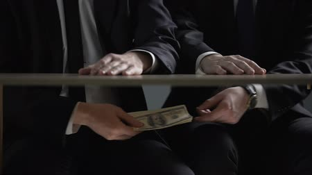 venality : Politician hands taking bribe money under office table, lobbying of interests Stock Footage