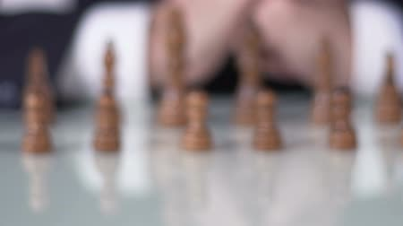 manipulacja : Chess competition, man in suit moving pawn on chessboard, business decision