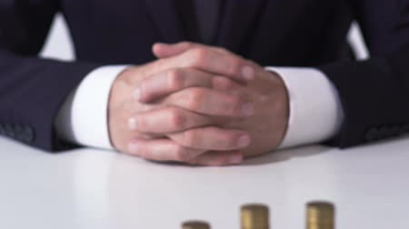 banqueiro : Coin piles on white office table, successful career and lucrative investment Stock Footage