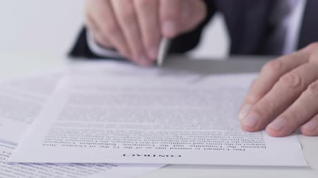 lucrative : Department head reading and signing contract documents, successful business deal Stock Footage