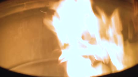 cylinder : Close-up of fire burning in barrel, source of heat and light for homeless people Stock Footage