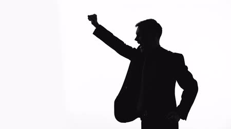 attainment : Silhouette of manager raising fists up, successful business plan, good bargain