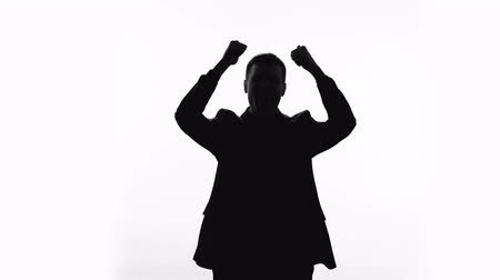 excelência : Happy businessman silhouette showing thumbs up, success, great achievement