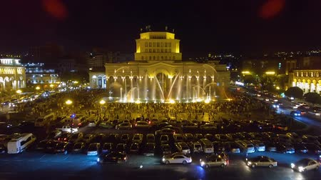 armenia : Hundreds of people walking around Republic Square looking at beauty of fountains