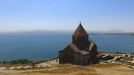 монастырь : Aerial panoramic view of Surp Arakelots and Astvatsatsin churches in Armenia Стоковые видеозаписи