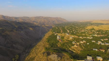 armenia : Wonderful aerial view of mountain valley and old Armenian village on sunny day Stock Footage