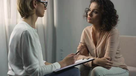 psychotherapist : Female psychologist listening female patient, depression and break-up, therapy