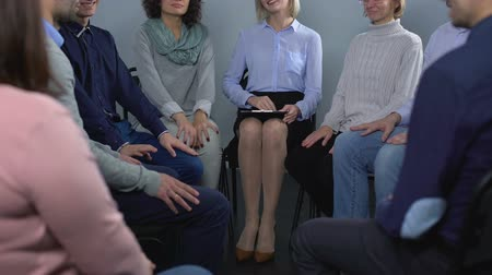 pszichológia : Rehabilitation therapy session, women and men talking with female psychologist
