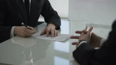 acceptance : Businessman giving male colleague cooperation contract for signing, partnership Stock Footage