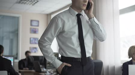 részvények : Happy businessman receiving good news on phone, successful company prosperity Stock mozgókép