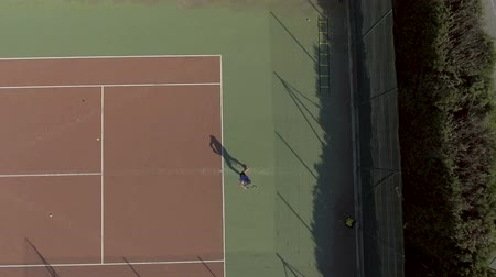 kurallar : Professional tennis player serving ball to his opponent at court, exercising