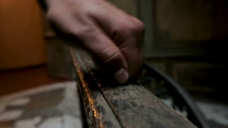 restorer : Experienced restorer assessing condition of wooden handrails at ancient building Stock Footage