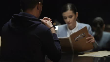 culpado : Thinking woman prosecutor reading criminal case documents, interrogation process Stock Footage