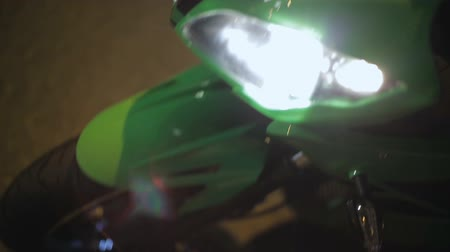 extreme close up : Motorcycle with switched on light bars, street race at night, closeup view Stock Footage