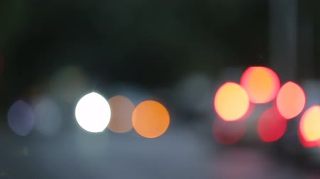 toll : Road traffic in evening city, blurred light spots changing into car headlights