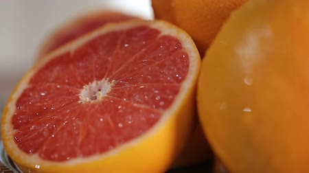 анти : Fresh grapefruits on the plate, prepared birthday table with fruits closeup