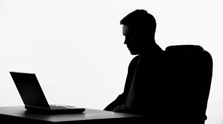 nervous breakdown : Broker silhouette shouting at laptop, nervous breakdown, business bankruptcy