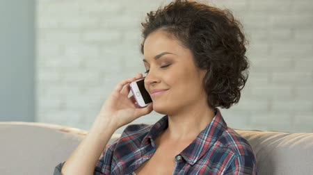 cellphone : Pretty brunette female making appointment with friend by mobile, communication