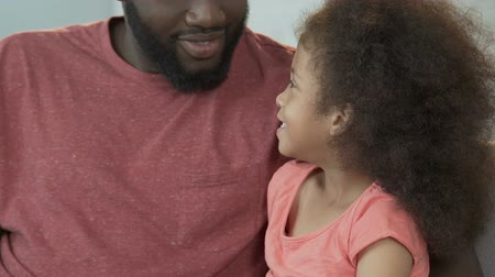 afro amerikan : Daughter and father having fun together, playing and laughing, family harmony