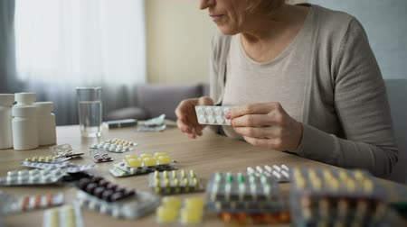prescribe : Obsessed with health care lady drinking pills with water, medicine overdose