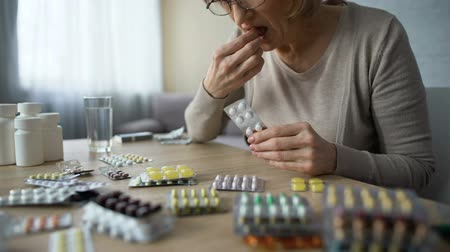 dose : Grandma taking pill, lonely sick woman suffering heart problem, prescription