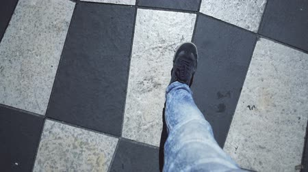 descuidado : Legs of independent young man walking chessboard square, breaking rules, pov