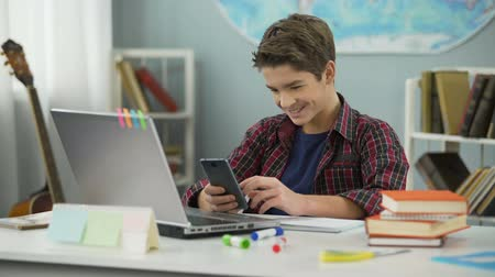 adolescents : Boy enthusiastically chatting online with girl he likes, first love feelings