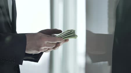 job transfer : Company manager receiving money cash wad from business partner, dividend income