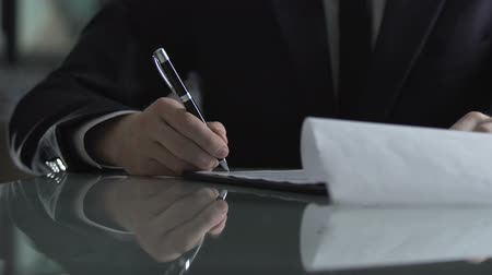 acceptance : Businessman signing contract after successful negotiation, deal acceptance Stock Footage