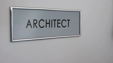 bater : Architect office door, hand knocking closeup, construction projects approval