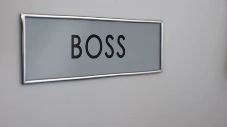bater : Boss office door, secretary hand knocking closeup, documents for signature
