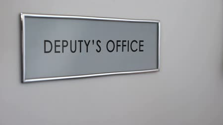 helyettes : Deputys office door, hand knocking closeup, director subordinate, politician