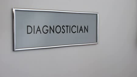 knock : Diagnostician office door hospital, hand knocking closeup, doctor consultation Stock Footage