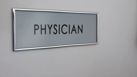 bater : Physician room door, hand knocking closeup, disease treatment, medical care
