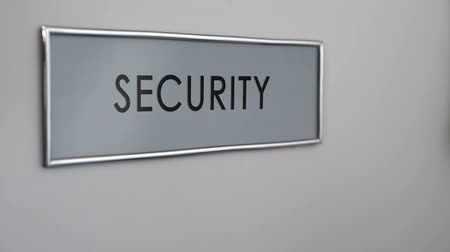 стучать : Security office door, hand knocking closeup, surveillance system, identification