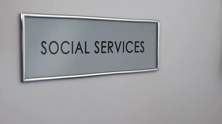 activist : Social services office door, hand knocking, senior people support, volunteering Stock Footage
