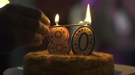 doğum günü : Hand lighting candles birthday cake, 80 anniversary celebration, tasty dessert