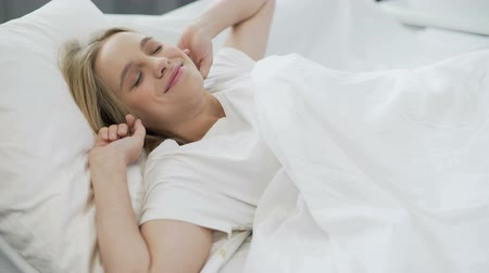 oneself : Healthy sleep on orthopedic mattress, happy teenage girl waking up with smile Stock Footage