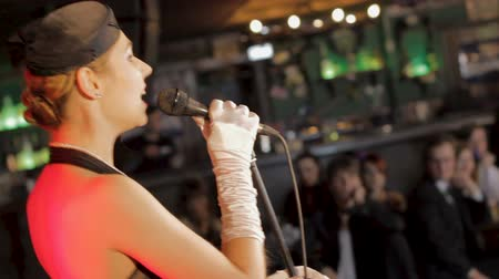 ゴージャス : Beautiful female jazz singer performing song at restaurant, celebration event
