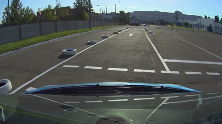 passar : Blue auto on asphalt autodrome with road markings driving exam, traffic rules