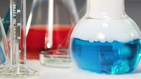 banka : Blue chemical substance with smoke boils in laboratory, chemical experiment