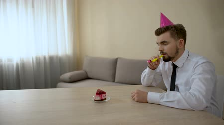 despedida de solteros : Sad lonely man in party hat celebrating birthday alone, depression, crisis Archivo de Video