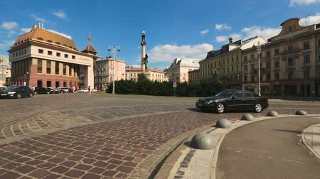культурный : City traffic on Lviv square with Adam Mickiewicz monument, cultural heritage