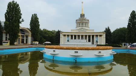 urss : Soviet VDNH architecture in Kiev square reflecting in fountain water, travel Stock Footage