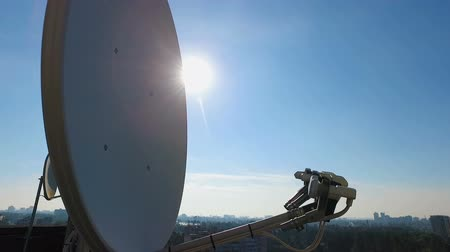 iletmek : Big satellite dishes on house roof catching radio waves, technology industry Stok Video